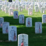Picture of graves decorated with flags at Arlington National Cemetery on Memorial Day